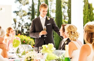Best Man Looking At Couple While Giving Speech During Reception